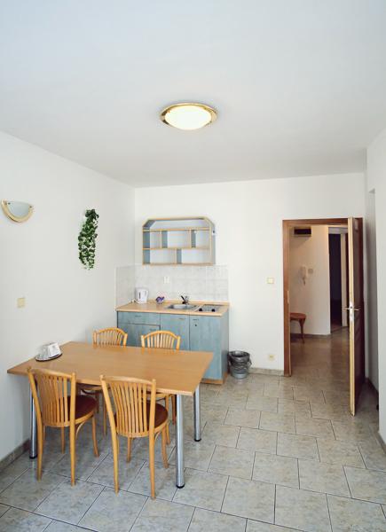Apartmán s 1 ložnicí - kuchyňský kout